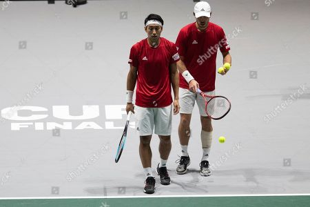 Japan's Ben McLachlan, right, and Yasutaka Uchiyama during their Davis Cup tennis double match against Serbia's Janko Tipsarevic and Viktor Troicki in Madrid, Spain