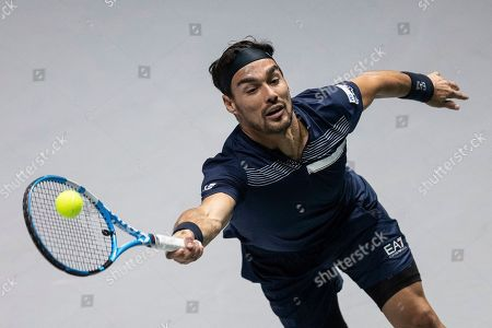 Italy's Fabio Fognini returns the ball to US Reilly Opelka during their Davis Cup tennis double match in Madrid, Spain