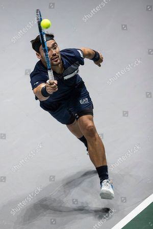 Stock Picture of Italy's Fabio Fognini returns the ball to US Reilly Opelka during their Davis Cup tennis double match in Madrid, Spain