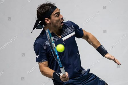 Stock Image of Italy's Fabio Fognini returns the ball to US Reilly Opelka during their Davis Cup tennis double match in Madrid, Spain