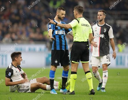 Stock Picture of Taken, Inter Milan's Marcelo Brozovic argues with referee Gianluca Rocchi during a Serie A soccer match between Inter Milan and Juventus, at the San Siro stadium in Milan, Italy. Nicola Rizzoli, who handles the Italian league's refereeing appointments and technical matters, said at a heated meeting among Serie A stakeholders that constant checks for involuntary handballs are putting too much strain on the video review system. In 119 Serie A matches through 12 rounds this season there have been 790 incidents checked by the VAR, which translates to 6.6 checks per match. That's up from 657 checks and 5.4 per match at this point last season