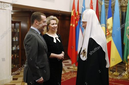 Stock Image of Russian Prime Minister Dmitry Medvedev (L) and his wife Svetlana Medvedeva (2-L) congratulate Patriarch Kirill of Moscow and All Russia on his birthday in Moscow, Russia, 20 November 2019.
