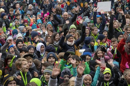 Swiss Federal Councillor Alain Berset, center top, meets children on Children's Rights Day, at the Federal Square in Bern, Switzerland, 20 November 2019. 30 years ago, the UN adopted the Convention on the Rights of the Child. Switzerland ratified the Convention on the Rights of the Child in 1997.