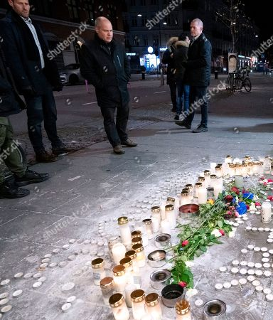 Stock Image of Morgan Johansson, Sweden's Minister of Justice visiting the spot where 15 year old Jaffar, 15, where gunned down in a square in central Malmo Sweden on October 10, 2019. A friend of Jaffar is hospitalized with gun shots. This was the one of many gang related murders in Sweden.