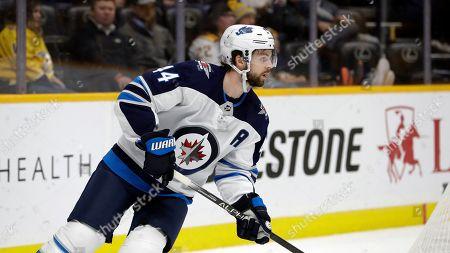 Winnipeg Jets defenseman Josh Morrissey plays against the Nashville Predators in the second period of an NHL hockey game, in Nashville, Tenn