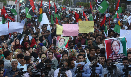 Supporters of the Pakistan People's party protest against the government, demanding the release of their leader Asif Ali Zardari and his sister Faryal Talpur, in Karachi, Pakistan, . A Pakistani court has handed over Zardari and his sister Faryal Talpur to a national anti-graft body for questions regarding a multi-million dollar money laundering case