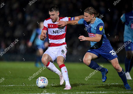 Ben Whiteman of Doncaster Rovers under pressure from Alex Samuel of Wycombe Wanderers