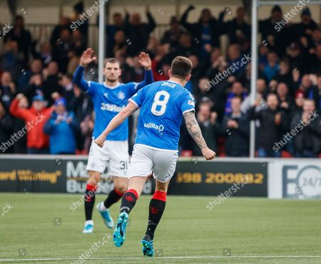 Ryan Jack of Rangers runs away from goal as he celebrates scoring to give Rangers a 1-0 lead.