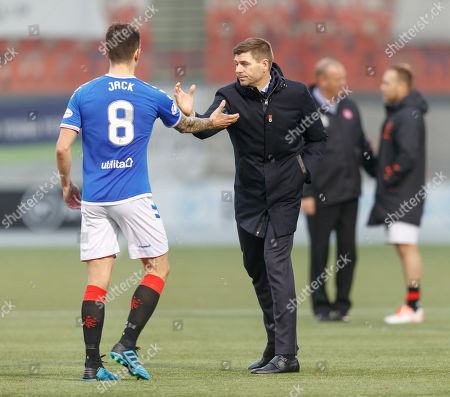 Ryan Jack of Rangers shakes hands with Rangers Manager Steven Gerrard after the final whistle