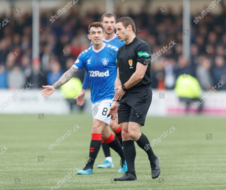Ryan Jack of Rangers protests to Referee Steven McLean after Ryan Kent of Rangers' shot hit Aaron McGowan on the arm inside the penalty area.