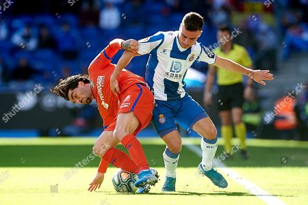 Victor Sanchez of RCD Espanyol and Jason Remeseiro of Getafe CF