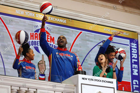 "Stock Photo of Cherelle Torch George, Nathaniel Big Easy Lofton, Donte Hammer Harrison, Betty Liu. NYSE Executive Vice Chairman Betty Liu, second from right, watches as members of the Harlem Globetrotters ring the New York Stock Exchange opening bell, . They are, from left, Cherelle ""Torch"" George, Nathaniel ""Big Easy"" Lofton, and Donte ""Hammer"" Harrison"