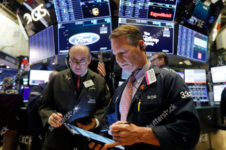 Andrew Silverman, Robert Charmak. Traders Andrew Silverman, left, and Robert Charmak work on the floor of the New York Stock Exchange, . Stocks are opening slightly lower on Wall Street led by declines in technology and communications companies