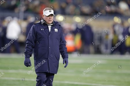 Notre Dame head coach Brian Kelly walks onto the field during the second half of an NCAA college football game against Navy, in South Bend, Ind. Notre Dame won 52-20