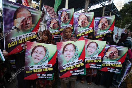 Stock Picture of Supporters of the oppositional Pakistan Peoples Party protest against the arrest of the party's chairman and former President Asif Ali Zardari and his sister Faryal Talpur, by the accountability body NAB, in Karachi, Pakistan, 20 November 2019. The co-chairman of the opposition Pakistan Peoples Party and Talpur are being investigated for alleged money laundering by a committee comprising of members of the Federal Investigation Agency and the intelligence services on the orders of the Supreme Court. According to recent report by the probe panel, the former president and his accomplices have laundered 4.3 billion rupees (around 28 million US dollar) through 29 bank accounts bearing names of third parties. Zardari has denied the allegations and claimed that the probe was politically motivated and instigated by the ruling Pakistan Tehreek-i-Insaf party led by Prime Minister Imran Khan.
