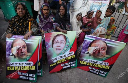 Stock Photo of Supporters of the oppositional Pakistan Peoples Party protest against the arrest of the party's chairman and former President Asif Ali Zardari and his sister Faryal Talpur, by the accountability body NAB, in Karachi, Pakistan, 20 November 2019. The co-chairman of the opposition Pakistan Peoples Party and Talpur are being investigated for alleged money laundering by a committee comprising of members of the Federal Investigation Agency and the intelligence services on the orders of the Supreme Court. According to recent report by the probe panel, the former president and his accomplices have laundered 4.3 billion rupees (around 28 million US dollar) through 29 bank accounts bearing names of third parties. Zardari has denied the allegations and claimed that the probe was politically motivated and instigated by the ruling Pakistan Tehreek-i-Insaf party led by Prime Minister Imran Khan.