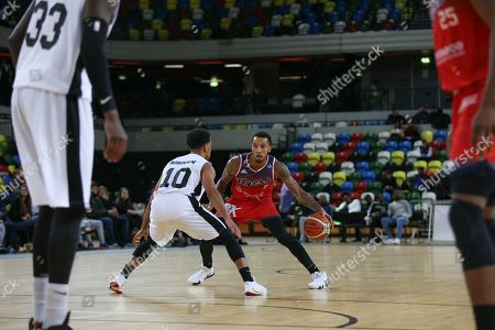 Gentry Thomas of Bristol Flyers tries to get past Justin Robinson of London Lions