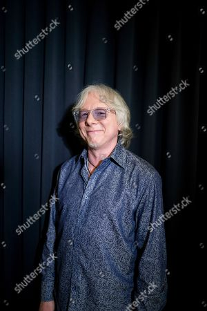 This photo shows Mike Mills from R.E.M posing for a portrait in New York