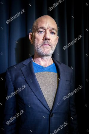 This photo shows former R.E.M. singer Michael Stipe posing for a portrait in New York his first solo song since that band retired in 2011