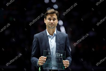 Former Spain's tennis player David Ferrer receives the Davis Cup Excellence Award during the Davis Cup finals at the Caja Magica facilities in Madrid, Spain, 20 November 2019.
