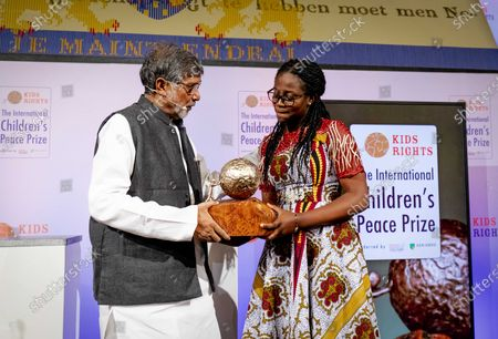 Kailash Satyarthi (L), Children's rights activist from India presents the International Children's Peace Prize 2019 to peace activist Divina Maloum (R) from Cameroon, in The Hague, The Netherlands, 20 November 2019.