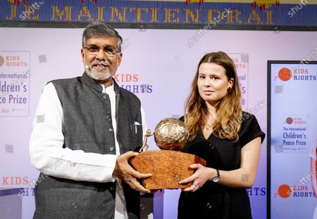 Kailash Satyarthi (L), Children's rights activist from India presents the International Children's Peace Prize 2019 to climate activist Luisa Neubauer (R) in The Hague, The Netherlands, 20 November 2019. Neubauer accepted the prize on behalf of the Swedish teenage climate activist Greta Thunberg, who could not be present at the award ceremony.