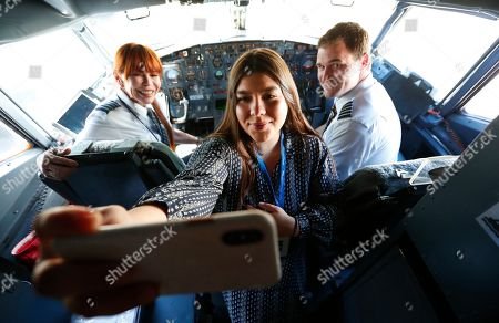 Madeline Alvarez, Linda Loparnos, James Tyler Myers. Madeline Alvarez, center, director of the Miami-Dade Walk to End Alzheimer's, takes a selfie with pilots Linda Loparnos, left, and James Tyler Myers, right, aboard a Boeing 737 as they participates in Miami International Airport's MIAair program, a dress rehearsal program that gives travelers a chance to practice the travel experience in a safe and controlled environment, at Miami International Airport in Miami. The airport partnered with the Alzheimer's Association and Swift Air to host a tour for Alzheimer's caregivers