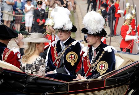"Dated, Britain's Prince William, right, Prince Andrew, second right, and Prince Edward, left, in their roles as Knight Companions and Edward's wife Sophie Countess of Wessex leave in a carriage after the Order of The Garter Service at Windsor Castle in Windsor, England. Britain's Prince Andrew said Wednesday Nov. 20, 2019, that he is stepping back from public duties with the queen's permission, saying that recent disclosures regarding his association with the late convicted sex offender Jeffrey Epstein have become a ""major distraction"" to the royal family's work"