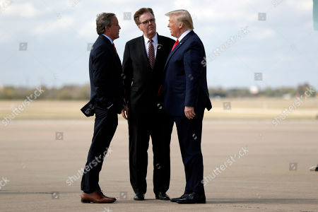 President Donald Trump talks Texas Lt. Gov. Dan Patrick, center, and Attorney General Ken Paxton, at Austin-Bergstrom International Airport for a visit to an Apple manufacturing plant, in Austin