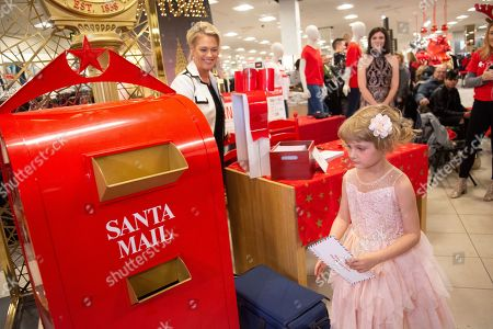 Five-year-old, Elizabeth Stanley mails a letter to Santa at Macy's Meadowood on in Reno, Nev. As part of Macy's Believe campaign, Macy's and Make-A-Wish® celebrate Wish Wednesday each week by granting the wishes of kids battling critical illnesses. Macy's Meadowood and Make-A-Wish® celebrate this Wish Wednesday by granting Elizabeth's wish to design a dress in New York City