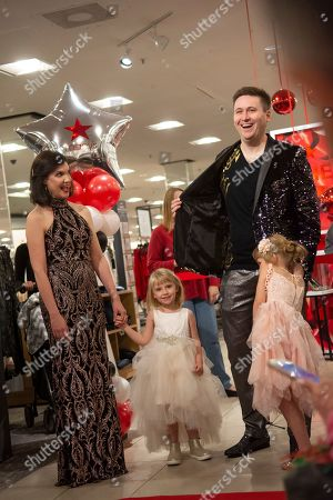 Five-year-old, Elizabeth Stanley, right, her parents, Erin and David, and younger sister, Caitlin during a fashion show at Macy's Meadowood on in Reno, Nev. As part of Macy's Believe campaign, Macy's and Make-A-Wish® celebrate Wish Wednesday each week by granting the wishes of kids battling critical illnesses. Macy's Meadowood and Make-A-Wish® celebrate this Wish Wednesday by granting Elizabeth's wish to design a dress in New York City