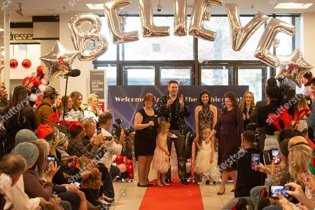 Five-year-old, Elizabeth Stanley, center, her parents David and Erin Stanley, and younger sister, Caitlin, and Macy's Meadowood women's sales manager, Connie Yale during a fashion show on in Reno, Nev. As part of Macy's Believe campaign, Macy's and Make-A-Wish® celebrate Wish Wednesday each week by granting the wishes of kids battling critical illnesses. Macy's Meadowood and Make-A-Wish® celebrate this Wish Wednesday by granting Elizabeth's wish to design a dress in New York City