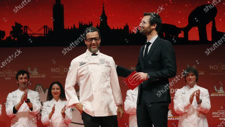 Spanish chef Quique Dacosta (L) of Denia restaurant, awarded with three Michelin stars, attends the presentation of the Michelin Spain and Portugal 2020 guide at the Lope de Vega theater in Seville, Andalusia, Spain, 20 November 2019.