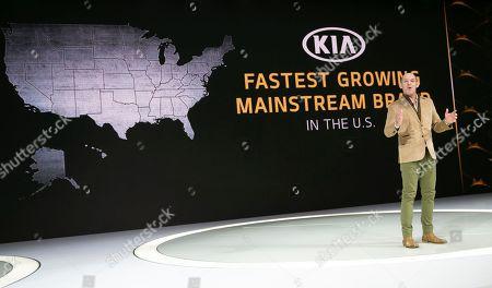 Stock Image of Michael Cole, president of Kia Motors America Inc., speaks at the AutoMobility LA Auto Show in Los Angeles