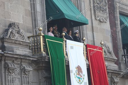 Mayor of Mexico City Claudia Sheinbaum (L), Mexican Secretary of Defense Luis Cresencio Sandoval (2-L), the President of Mexico Andres Manuel Lopez Obrador (C), his wife Beatriz Gutierrez (2-R), and the Secretary of the Navy, Jose Rafael Ojeda Duran (R), attend the parade commemorating the 109th Anniversary of the Mexican Revolution, in Mexico City, Mexico, 20 November 2019.