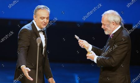 Stock Photo of Terry Gilliam (R) receives a Lifetime Achievement Award from Egyptian producer Mohamed Hefzy (L) during the opening ceremony of the 41st Cairo International Film Festival (CIFF), in Cairo, Egypt, 20 November 2019. The CIFF runs from 20 to 29 November.