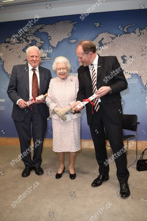 Queen Elizabeth II, presents the Chatham House Prize 2019 to Sir David Attenborough and Julian Hector, Head of the BBC Natural History Unit.