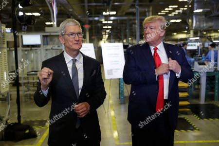 Apple CEO Tim Cook and President Donald Trump speak during a tour of an Apple manufacturing plant, in Austin