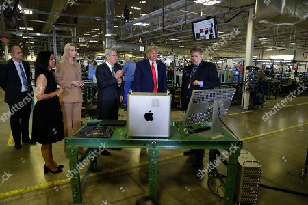 Stock Image of President Donald Trump tours an Apple manufacturing plant, in Austin with Apple CEO Tim Cook and Ivanka Trump, the daughter and adviser of President Donald Trump, left