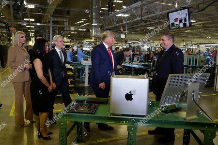 Stock Photo of President Donald Trump tours an Apple manufacturing plant, in Austin with Apple CEO Tim Cook and Ivanka Trump, the daughter and adviser of President Donald Trump, left