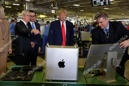 Stock Picture of President Donald Trump tours an Apple manufacturing plant, in Austin with Apple CEO Tim Cook and Ivanka Trump, the daughter and adviser of President Donald Trump, left