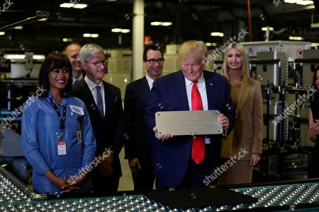 President Donald Trump tours an Apple manufacturing plant, in Austin with Apple CEO Tim Cook and Ivanka Trump, the daughter and adviser of President Donald Trump, left