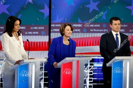 Democratic presidential candidates Rep. Tulsi Gabbard, D-Hawaii, Sen. Amy Klobuchar, D-Minn., and South Bend, Ind., Mayor Pete Buttigieg, from left, participate in a Democratic presidential primary debate, in Atlanta