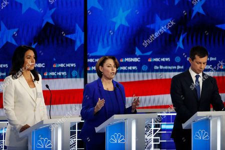 Democratic presidential candidate Sen. Amy Klobuchar, D-Minn., center, speaks as South Bend, Ind., Mayor Pete Buttigieg and Rep. Tulsi Gabbard, D-Hawaii, listen during a Democratic presidential primary debate, in Atlanta