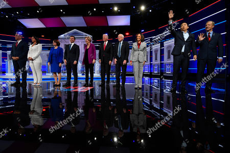 Democratic presidential candidates from left, Sen. Cory Booker, D-N.J., Rep. Tulsi Gabbard, D-Hawaii, Sen. Amy Klobuchar, D-Minn., South Bend, Ind., Mayor Pete Buttigieg, Sen. Elizabeth Warren, D-Mass., former Vice President Joe Biden, Sen. Bernie Sanders, I-Vt., Sen. Kamala Harris, D-Calif., former technology executive Andrew Yang and investor Tom Steyer wave to the audience before a Democratic presidential primary debate, in Atlanta