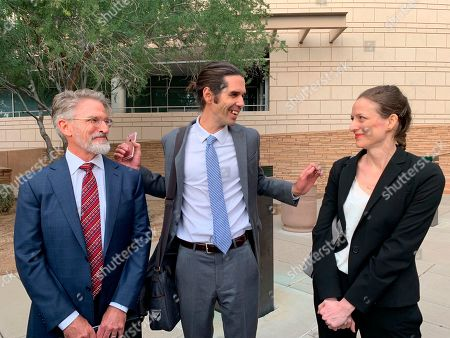 Scott Warren, center, of Ajo, Ariz., celebrates with his attorneys Amy Knight, right, and Greg Kuykendall outside court in Tucson, Ariz., after being acquitted of two counts of harboring in a case that garnered international attention. Prosecutors said Warren illegally helped two migrants avoid authorities. He said he was fulfilling his humanitarian duties by helping two injured men