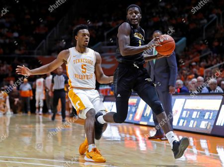 Alabama State guard Leon Daniels (1) catches an inbound pass as he's defended by Tennessee guard Josiah-Jordan James (5) during the first half of an NCAA college basketball game, in Knoxville, Tenn