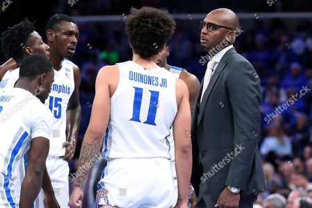 Memphis coach Penny Hardaway huddles with his players duirng the second half of the team's NCAA college basketball game against Little Rock, in Memphis, Tenn