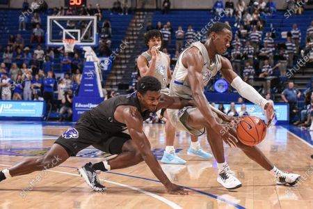 High Point Panthers guard John-Michael Wright (1) is able to reach in and knock the ball away from Saint Louis Billikens forward Javonte Perkins (3) during a regular season game where the High Point Panthers visited the St. Louis Billikens. Held at Chaifetz Arena in St. Louis, MO Richard Ulreich/CSM