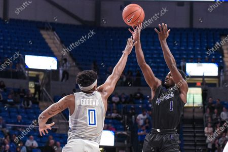 High Point Panthers guard John-Michael Wright (1) shots the ball over the defense of Saint Louis Billikens guard Jordan Goodwin (0) during a regular season game where the High Point Panthers visited the St. Louis Billikens. Held at Chaifetz Arena in St. Louis, MO Richard Ulreich/CSM